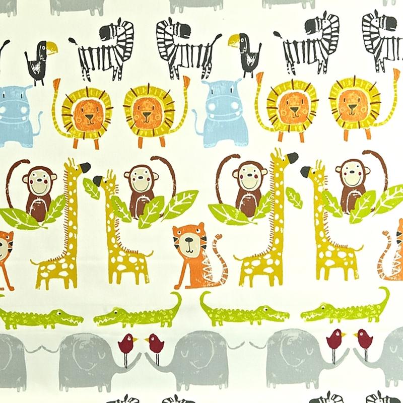 Kinderzimmer Stoff 'Dschungeltiere' grün/gelb
